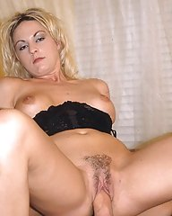 Pretty blonde porn babe with nice titties and hairy cunt gets it crammed with a thick stiff rod