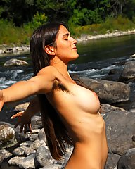 Incredible hirsute Alexia has long brunette hair, full bush, treasure trail and hairy armpits.