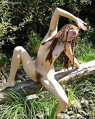 Long dreadlocks, beautiful, hippie girl with hairy pits and full bush, outdoors.