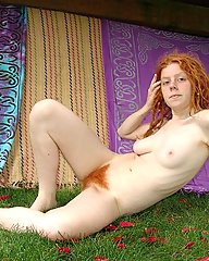 Hairy Red dreadlock haired young hippie with exquisite flaming bush/pits in the garden.