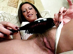 Liza Harper plays with her bushy twat combing its hair before getting spoon fucked